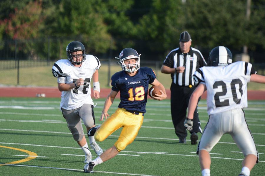 Sophomore Reese Atkinson carries the ball against Cistercian.