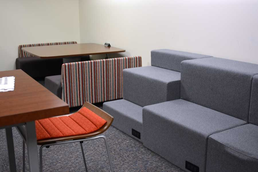 New seating includes padded risers, a nook and raised bar stools.