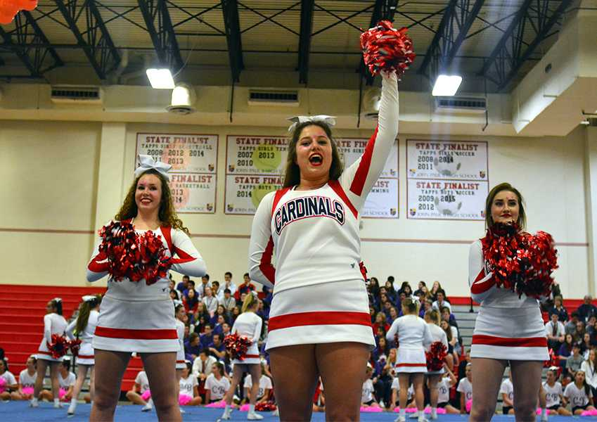 Varsity captain Madison Meek leads Shannon Rosing and Lindsay Zugelder in a spirit call at the homecoming pep rally.